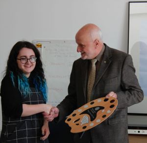 Rotary Young Artist of the Year Emma Cameron receives her prize